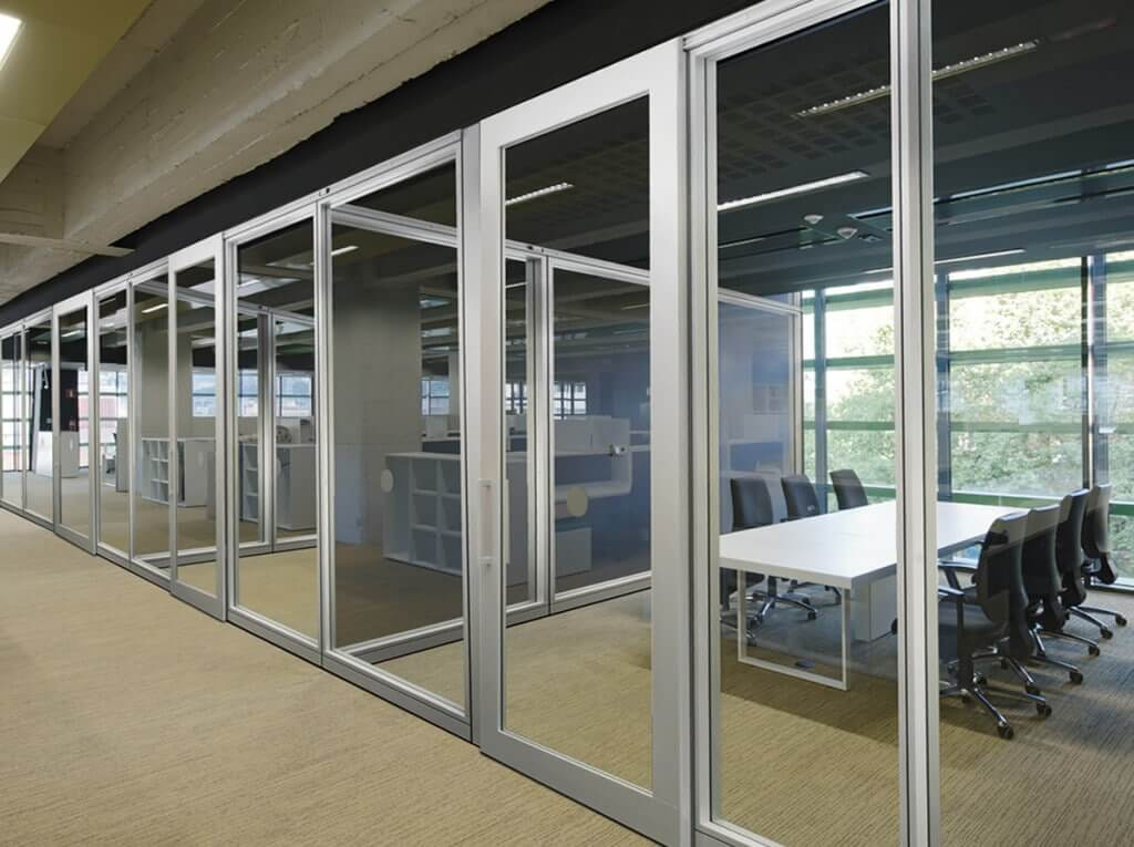 Increase productivity and communication with frameless glass doors for Sliding glass wall doors