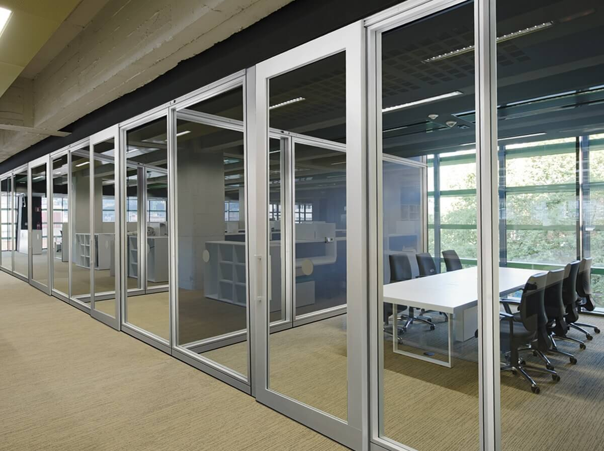 Increase productivity and communication with frameless for Sliding glass wall systems